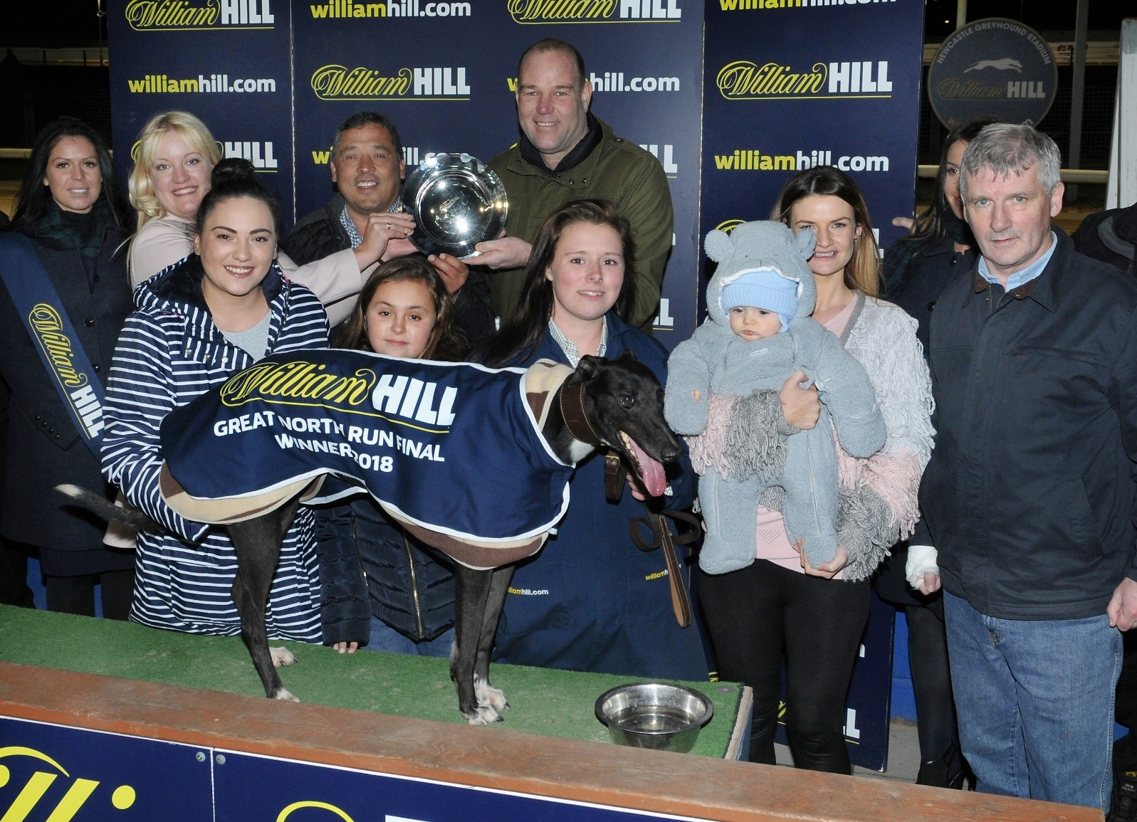 "Owner Emma Wright with Baby "" Tommy "" at presentation for Droopys Live at Great North Run  winner in 2018 Owners Paul Marragh & John Hardman also in frame"